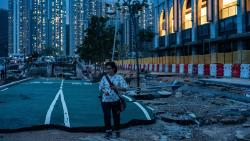 A woman walks along a ruined cycling path destroyed by Typhoon Mangkhut in Tseung Kwan O district in Hong Kong on Monday.