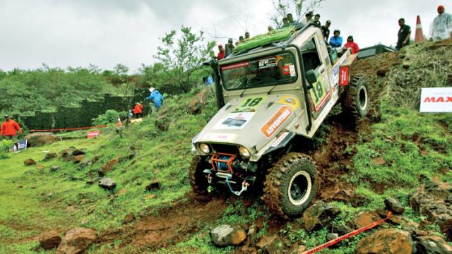 A Thar in action while crossing a natural terrain full of boulders during the Mahindra Great Escape challenge at the rugged 19 Degree North in Lonavala.