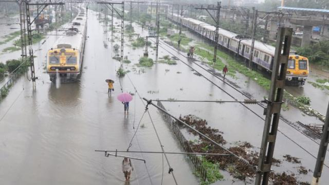 Suburban trains chug on water-logged tracks during heavy rains