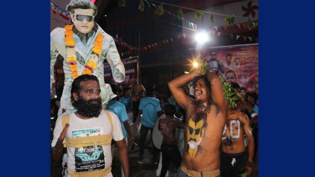 Mumbai: Rajinikanth fans celebrating First Day First Show for Movie 2.0 Robot..at Carnival Cinemas Imax wadala on Thursday. Fans showers flowers, abhishek with milk, a special pooja and fans taking selfie, showing movie tickets and celebration early morni