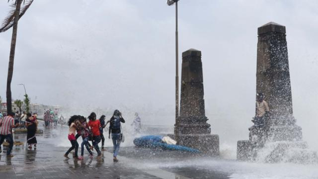 Mumbai: People enjoying during high tide at Marine Drive on Saturday. (Pics Prashant Sawant)