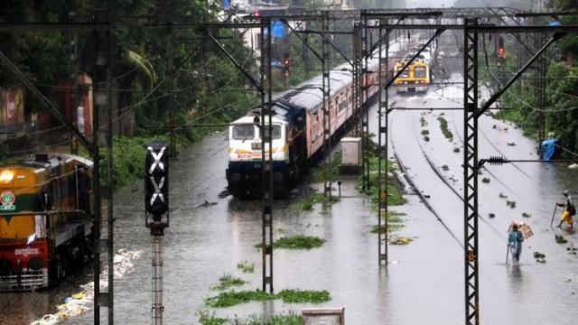 Waterlogged railway tracks between Sion and Matunga after heavy rainfall in Mumbai on Monday.