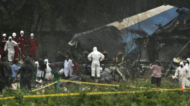 Rescue teams search through the wreckage site of a Boeing 737 that plummeted into a cassava field with more than 100 passengers on board, in Havana, Cuba, Friday, May 18, 2018. AP/PTI