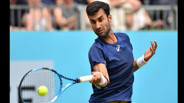 India's Yuki Bhambri returns to Canada's Milos Raonic during their first round men's singles match at the ATP Queen's Club Championships tennis tournament in west London on June 19, 2018. Glyn Kirk/AFP