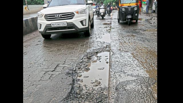 The road near Swargate Chowk has many potholes. Anand Chaini/Sakal Times