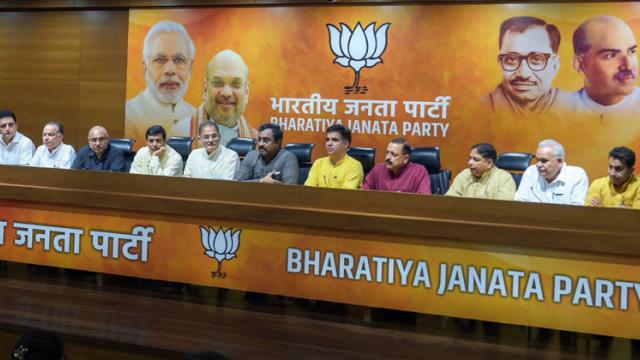 BJP in-charge for J&K Ram Madhav, flanked by the party leaders from the state, addresses a press conference, in New Delhi on Tuesday, June 19, 2018. Shahbaz Khan/PTI