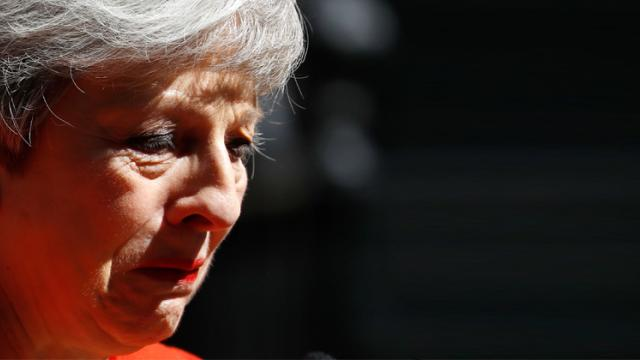 Britain's Prime Minister Theresa May reacts as she announces her resignation outside 10 Downing Street in London on May 24, 2019. AFP Photo