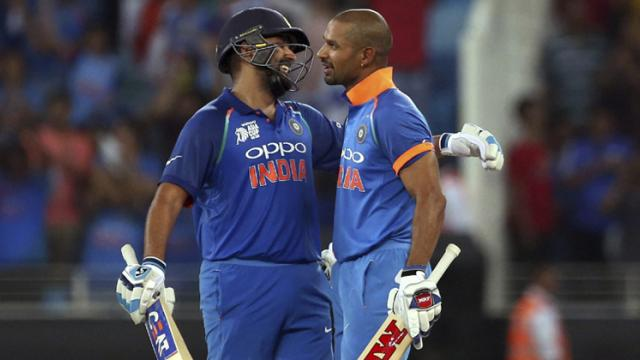India's captain Rohit Sharma, left, hugs to congratulate teammate Shikhar Dhawan on scoring a century during the one day international cricket match of Asia Cup between India and Pakistan in Dubai, United Arab Emirates on Sunday.