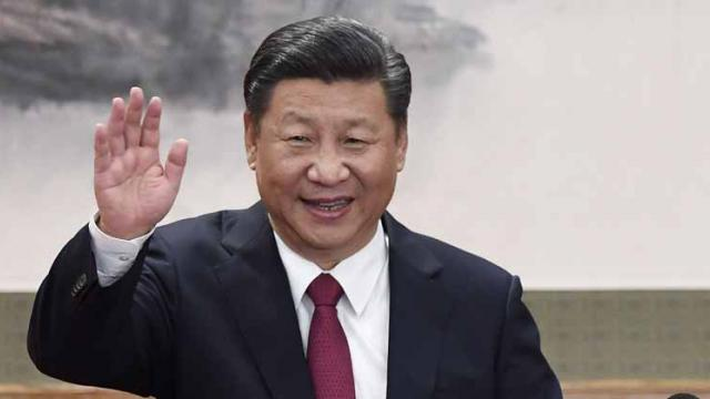 This file photo taken on October 25, 2017 shows Chinese President Xi Jinping waving at the Great Hall of the People in Beijing.