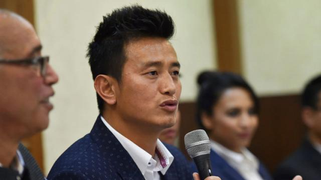 Former Indian football team captain Bhaichung Bhutia speaks during the launch of his political party 'Hamro Sikkim' during a press conference in New Delhi on Thursday. PTI Photo by Arun Sharma