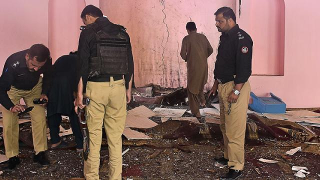 Pakistani police officials examine the interior of a mosque after a blast on the outskirts of Quetta on May 24, 2019. AFP Photo