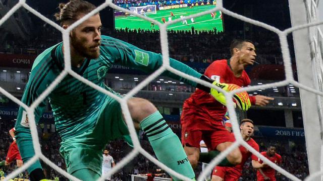 Portugal's forward Cristiano Ronaldo celebrates scoring a goal after shooting a penalty kick against Spain's goalkeeper David De Gea. Nelson Almeida/AFP