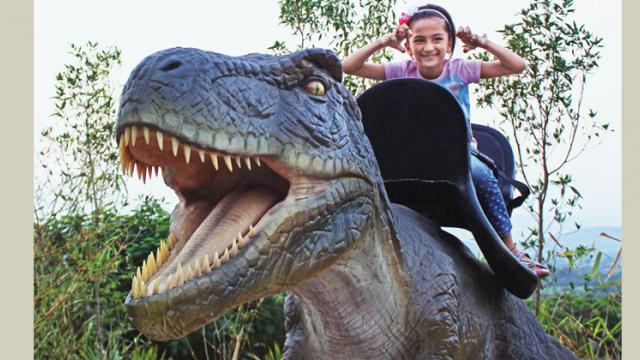 Children can ride coin-operated dinosaurs at Dino Park