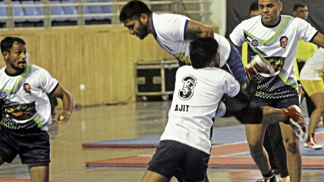 A player from Laybhari Pimpri Chinchwad tries to jump above Zunzhar Khed defenders during the opening match of the Pune Kabaddi League match on Friday.