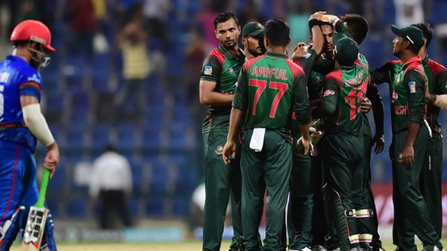 Bangladesh team celebrates the victory during the one day international (ODI) Asia Cup cricket match between Afghanistan and Bangladesh at The Sheikh Zayed Stadium in Abu Dhabi on Sunday.