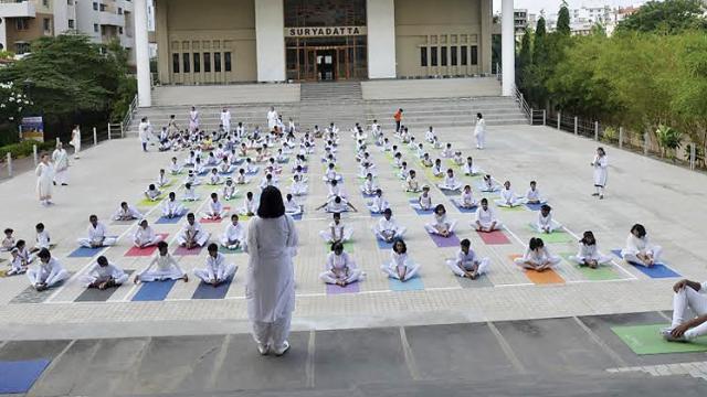 Suryadatta National School and Surya Kids celebrated Yoga Day at Surya Bhavan with Yoga aasana followed by  a meditative bajan.
