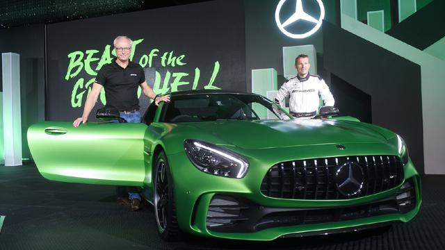 Roland Folger, MD & CEO, Mercedes Benz India with AMG Driver Christian Hohenadel at the launch of the AMG GT R and AMG GT Roadster in New Delhi on Monday.