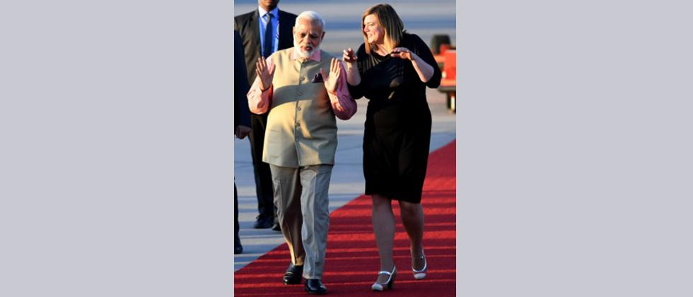 Indias President Narendra Modi chats with Hamburgs deputy major Katharina Fegebank after arriving at the airport in Hamburg
