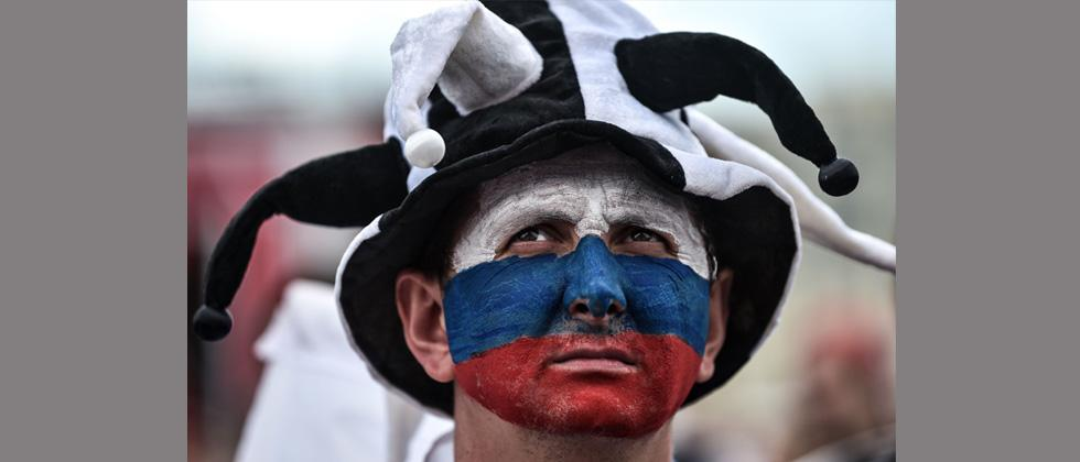 A Russian football fan reacts as he watches the Russia 2018 World Cup Group A football match between Russia and Saudi Arabia at the Fan zone in Kaliningrad on Thursday.