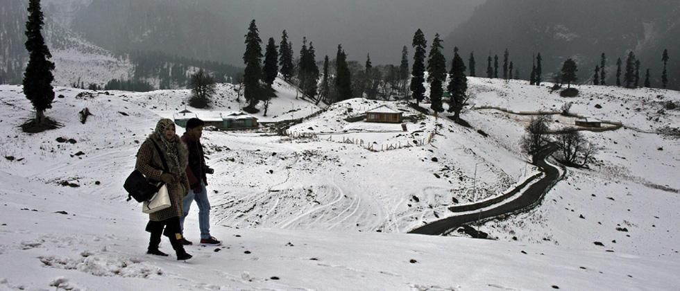 Sonamarg: Tourists enjoying a walk on snow coverd tourist resort Sonamarg after season's first snowfall. Snowfall in higher reaches and rains in plains have ended extended dry spell in Kashmir Valley, bringing respite to the people.
