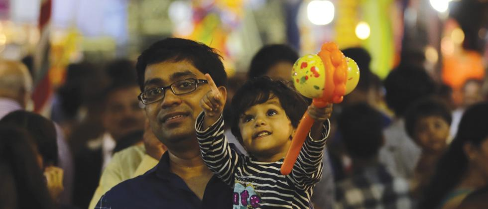 Happy children gazing at the colourfully lit decorations by the Ganesh Mandals are a big part of the crowd storming the heart of the city to take darshan of their beloved deity
