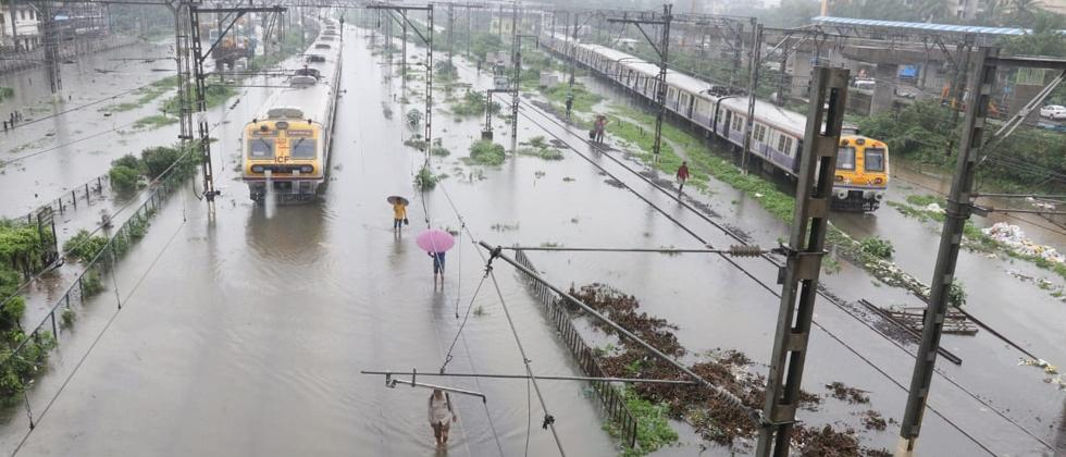 Suburban trains chug on water-logged tracks during heavy rains