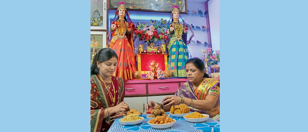 Women preparing for the puja at their home in Pune