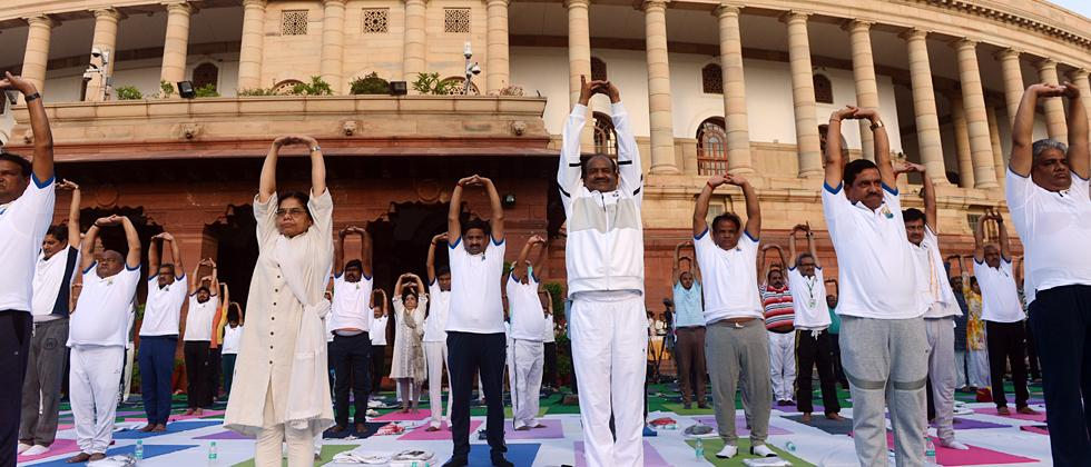 Lok Sabha Speaker Om Birla along with parliamentarians and parliament staff performs yoga on International Day of Yoga in front of Parliament in New Delhi