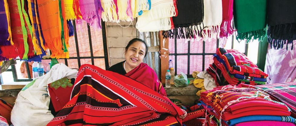 A woman sells woollen shawls at Eima Market, Manipur (Pic: Kaynat Kazi)