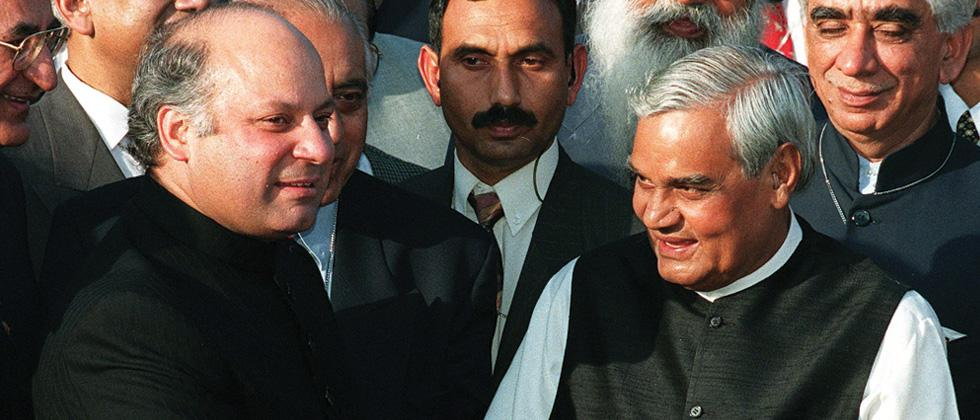 The then prime minister of Pakistan Nawaz Sharif (L) receives his then Indian counterpart Atal Behari vajpayee at the Wagah Border in 1999.
