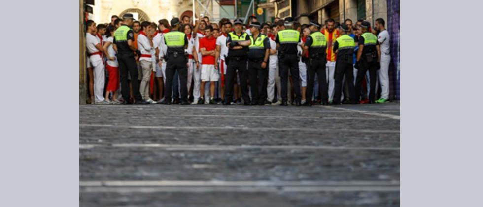 Participants wait for the start of the bull run on the first day of the San Fermin bull run festival in Pamplona, northern Spain.