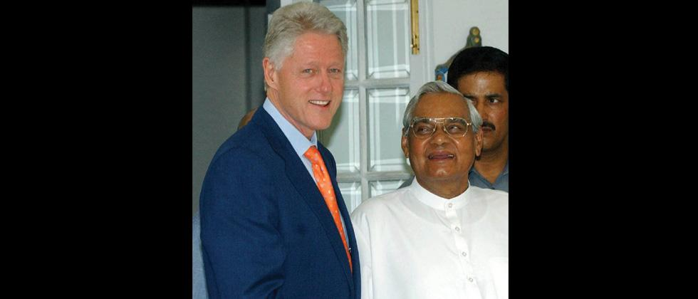 Former US president Bill Clinton shakes hands with Atal Bihari Vajpayee before the meeting in New Delhi in 2005