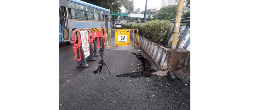 Portion of road caves in near near Sancheti square on Tuesday night. As per the officials of Pune Municipal Corporation, the cave in occured due to repair work of pipe line  undertaken by the water department.