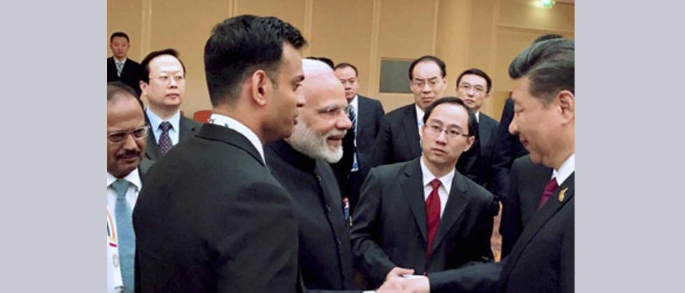 Prime Minister Narendra Modi and Chinese President Xi Jinping exchange greetings at the BRICS leaders' informal gathering hosted by the China, in Hamburg, Germany