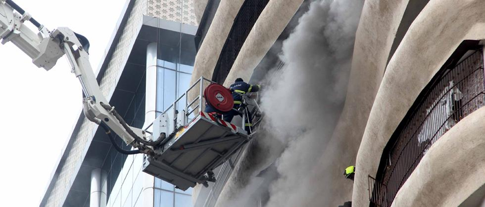 Fire brigade personnel seen rescuing people from the 17-storey Crystal Tower building that caught fire at Hindmata in Parel on Wednesday. Pics by: Prashant Sawant.