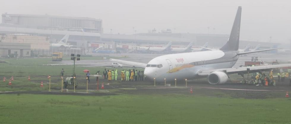 A SpiceJet flight skid and overshot the main runway while landing at the Mumbai airport