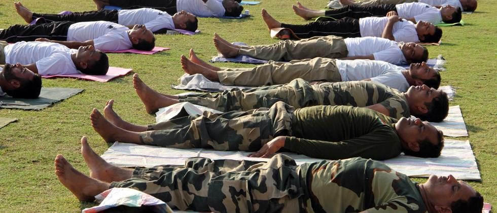Border Security Force (BSF) jawans perform yoga on International Day of Yoga in Jammu
