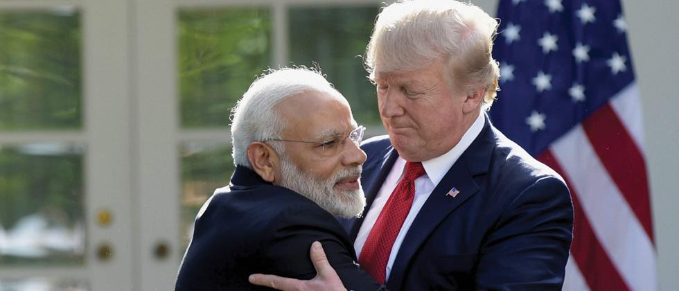 President Donald Trump and Prime Minister Narendra Modi hug while making statements in the Rose Garden of the White House in Washington on Monday.