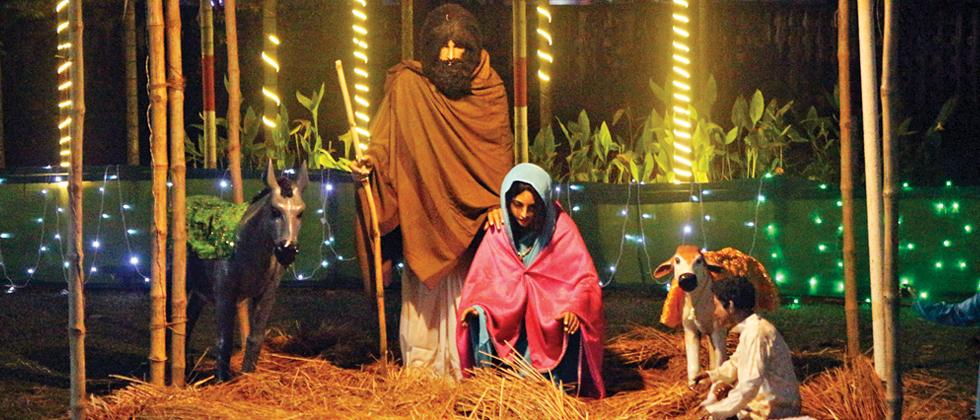 The nativity scene looks beautiful with fairy lights in the background (Pic: Tirthankar Das)