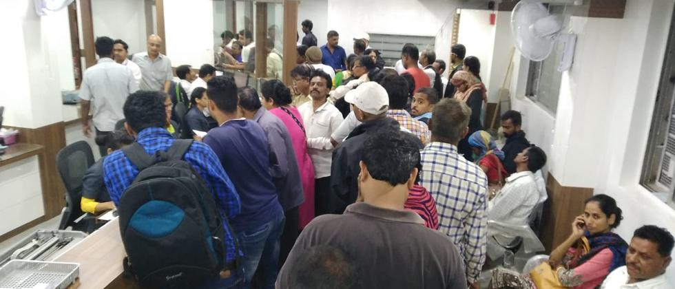 Customers of the Cosmos Cooperative Bank rush to the banks to withdraw money after ATM and online transactions of the bank were shut down following a suspicious cyber attack in which Rs 94 crore were siphoned off between August 11 to August 13.