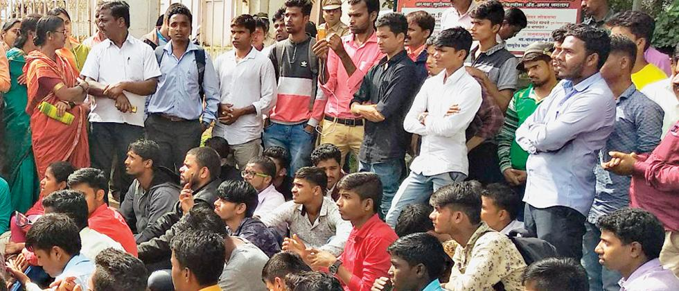 Tribal students sitting outside Ghodegaon project office in Junnar.