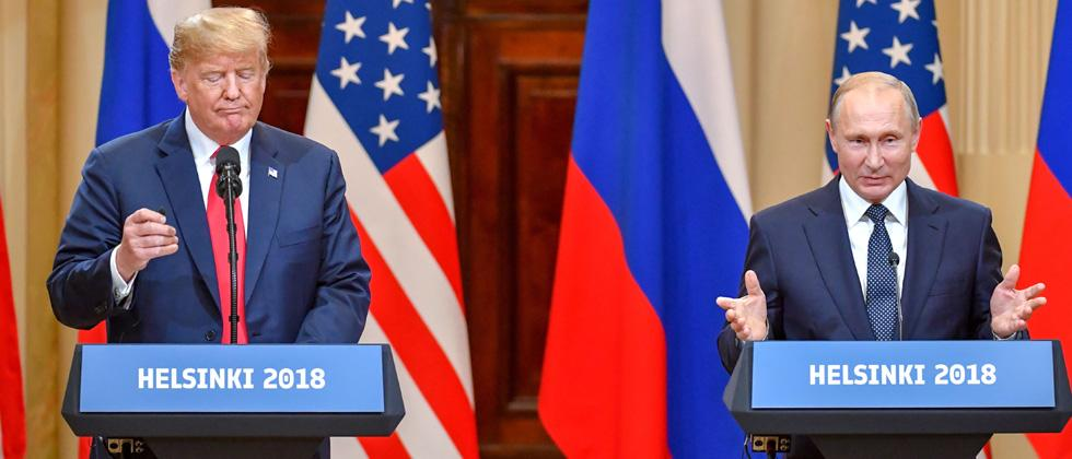 US President Donald Trump (L) and Russia's President Vladimir Putin attend a joint press conference after a meeting at the Presidential Palace in Helsinki, on Monday.
