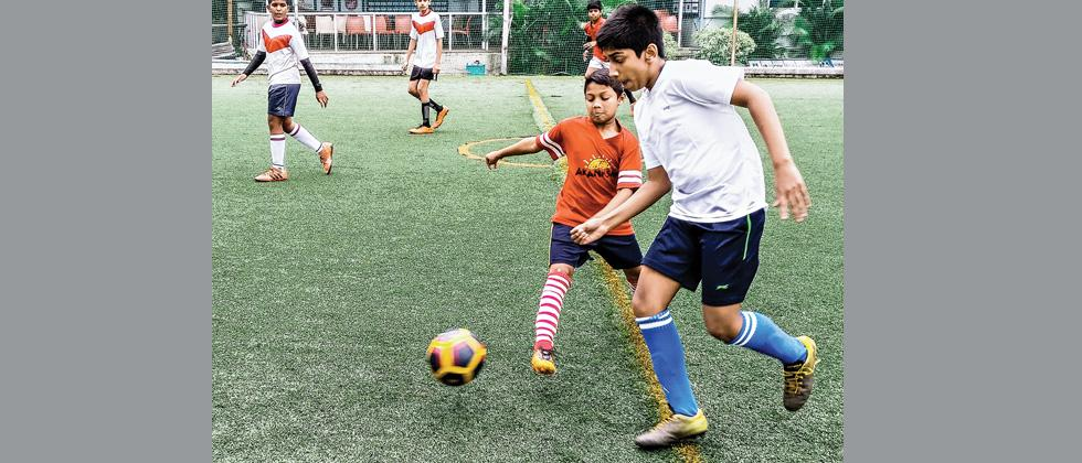 A match in progress between Indira National School (white) and Matoshri School in the Green Box Football tournament on Thursday.