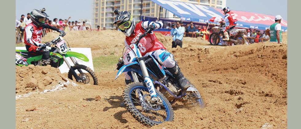 Harith Noah controls his TVS RTR bike in National Supercross Championship.