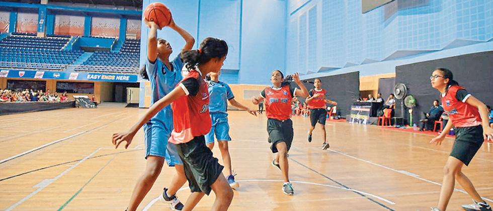 A player from Pune (blue) team tries to score a basket during their match against Mumbai South East on Monday.