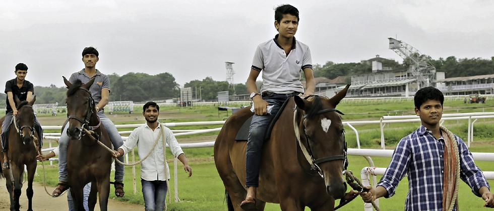 Race horses being taken out for track work on Wednesday morning, a day ahead of the opening races at the Pune Race Course. Pune Monsoon racing season kick starts on Thursday