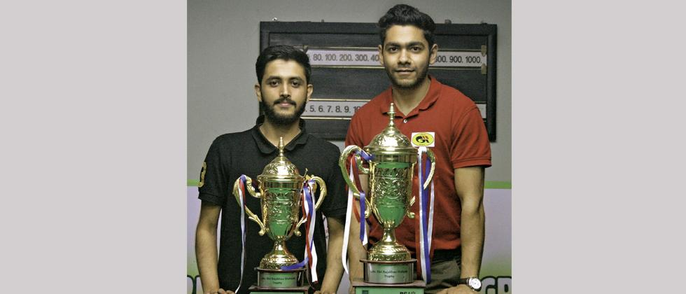 Rahul Sachdev (left) and Ketan Chawla pose with their trophies.
