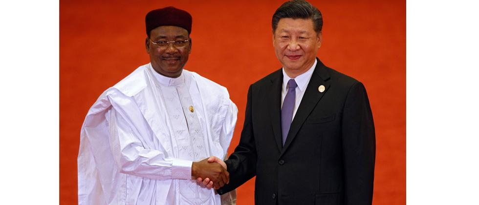 Niger's President Mahamadou Issoufou (L) shakes hands with China's President Xi Jinping as they pose for photograph during the Forum on China-Africa Cooperation at the Great Hall of the People in Beijing on Monday.