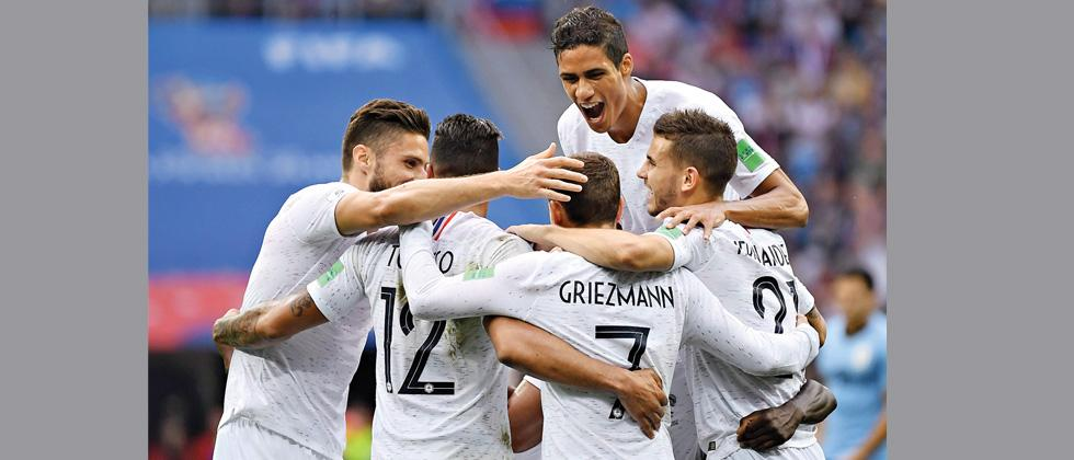 France's forward Antoine Griezmann (No 7) celebrates with teammates after scoring their second goal agains Uruguay during the World Cup quarter-final on Friday.