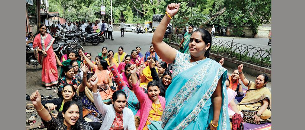 State government employees protest outside the District Collectorate near Pune station on Tuesday, the first day of the three-day State-wide strike.